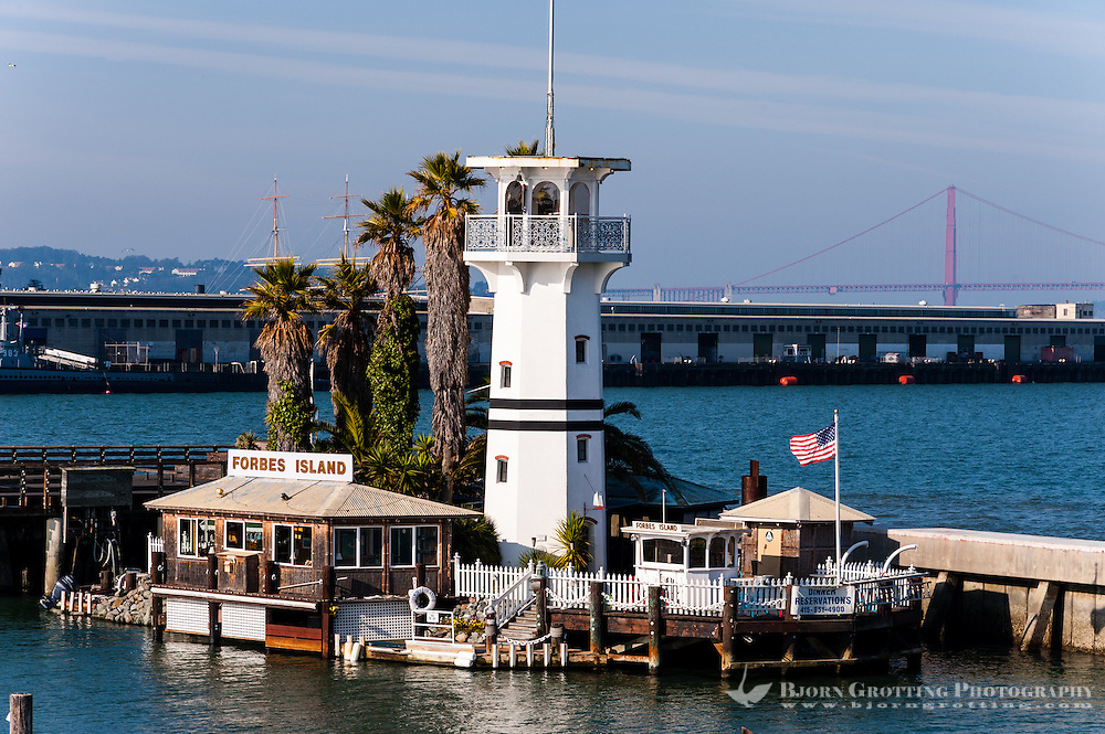 United States, California, San Francisco. Pier 39, Forbes Island with Golden Gate bridge in the background.