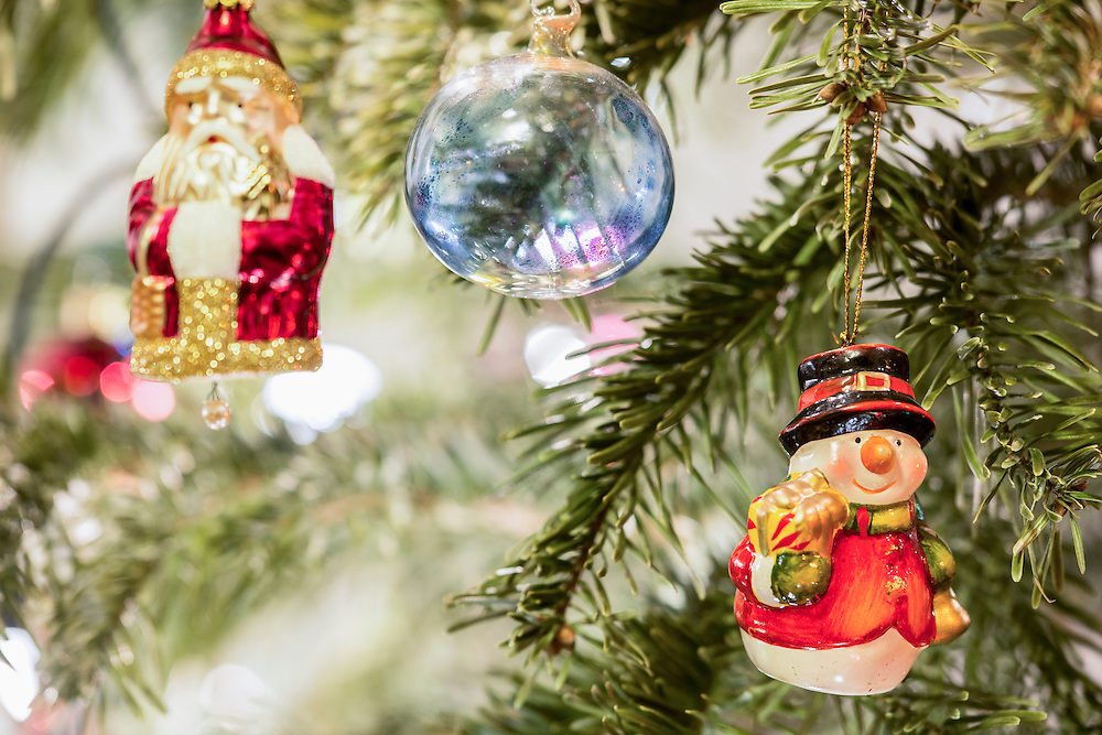 Christmas baubles and Santa Claus hanging on Christmas tree, Munich, Germany