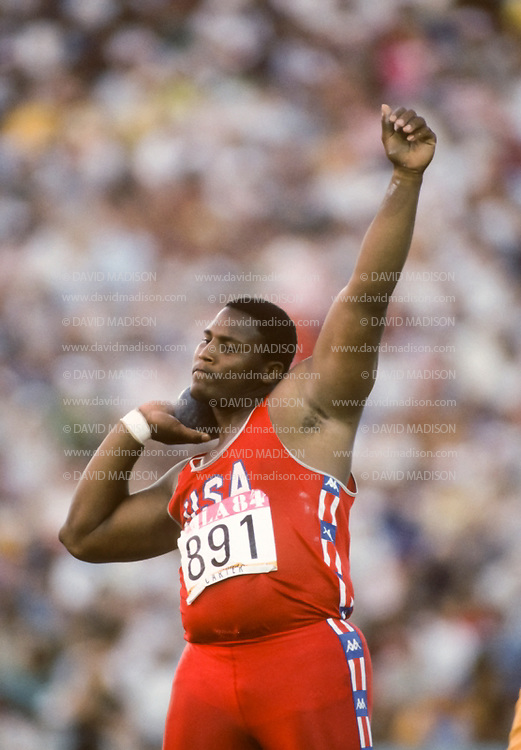 LOS ANGELES -  AUGUST 11:  Michael Carter of the USA competes in the Men's Shot Put event of the 1984 Olympic Games on August 11, 1984 in the Los Angeles Coliseum in Los Angeles, California.  Carter was the silver medalist in the event. (Photo by David Madison/Getty Images) *** Local Caption *** Michael Carter