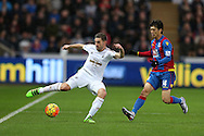 Angel Rangel of Swansea city is challenged by Lee Chung-yong of Crystal Palace ®. Barclays Premier league match, Swansea city v Crystal Palace at the Liberty Stadium in Swansea, South Wales on Saturday 6th February 2016.<br /> pic by Andrew Orchard, Andrew Orchard sports photography.