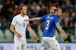 Harry Kane of England is marked by Giorgio Chiellini (capt) of Italy - Photo mandatory by-line: Rogan Thomson/JMP - 07966 386802 - 31/03/2015 - SPORT - FOOTBALL - Turin, Italy - Juventus Stadium - Italy v England - FIFA International Friendly Match.