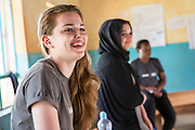 Cathryn Tomnay  with team of volunteers prepare for their school training session with pupils as part of the ICS Raleigh SWASH (school water, sanitation and hygiene plan) project. Mbulu, Manyara district, Tanzania. Working in partnership with the Diocese of Mbulu Development Department (DMDD); part of Caritas Tanzania.
