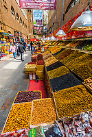 Nuts, raisins and other dried fruit for sale in the open air International Grand Bazaar, Urumqi, Xinjiang Province, China. Most raisins come from Xinjiang. China the world's third-largest producer of raisins and the world's largest producer of green raisins.
