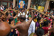 Hindu devotees participate in the annual Tamil chariot festival at the Murugan Temple in Highgate, London, England 17th July 2016. Thousands attend the colourful celebration as the temple's Goddess Amman (Tamil for Mother) is paraded on a beautifully decorated chariot pulled by the people through the streets around the temple, which brings to a close the four week Mahotsava festival. The chariot is pulled by rope by women on one side, men on the other.