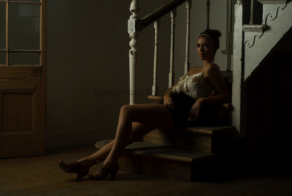 Beautiful woman poses in old building