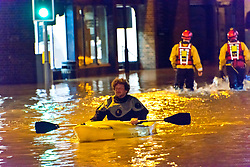 © Licensed to London News Pictures. 24/02/2020. Shrewsbury, Shropshire, UK. People help and rescue as The Shropshire Fire and Rescue Service carry out an evacuation operation in the Coleham area of Shrewsbury in Shropshire as the River Severn levels continue to rise UK causing severe flood disaster situations. The Environment Agency forecast levels to peak tomorrow evening at around 5.56 metres. Photo credit: Graham M. Lawrence/LNP