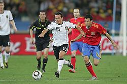 07.07.2010, Moses Mabhida Stadium, Durban, SOUTH AFRICA, Deutschland ( GER ) vs Spanien ( ESP ) im Bild Piotr Trochowski of Germany and Sergio Busquets of Spain.Foto ©  nph /  Kokenge / SPORTIDA PHOTO AGENCY