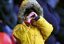 A young fan in the stands looks through a small telescope during the Premier League match at the Vitality Stadium, Bournemouth.
