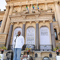 CHESTER WILLIAMS, 1995 Rugby World Cup winner and former Springbok addresses the crowd. The City of Cape Town hosted an interfaith service on the Grand Parade as the day was declared a national day of prayer and reflection on the life of Nelson Mandela. Visitors also placed flowers and condolence messages on the barricade erected to accommodate it. Various religious leaders said prayers for the late South African President