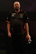 The body language says it all. Raymond van Barneveld looking dejected as he walks off stage after the World Championship Darts 2018 at Alexandra Palace, London, United Kingdom on 17 December 2018.