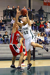 10 January 2009: Katherine Burshiem moves under Stacey Arlis but Arlis hooks the shot getting the ball past Burshiem The Illinois Wesleyan Titans, ranked #1 in the latest USA Today/ESPN poll, take down the Lady Reds of Carthage and remain undefeated,  2-0 in the CCIW and over all to 12-0. This is the first time in the history of the Lady Titans Basketball they have been ranked #1 The Titans and Lady Reds played in the Shirk Center on the Illinois Wesleyan Campus in Bloomington Illinois.
