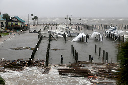 October 10, 2018 - Port St. Joe, Florida, U.S. - Boats lay sunk and damaged at the Port St. Joe Marina in the Florida Panhandle on Wednesday after Hurricane Michael made landfall near Mexico Beach. The storm lashed the coast with 155 mph winds, just shy of a Category 5 storm. (Credit Image: © Douglas R. Clifford/Tampa Bay Times via ZUMA Wire)