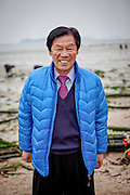 """Portrait of a visitor to Jindo island. Jindo is the 3rd biggest island in South Korea located in the South-West end of the country and famous for the """"Mysterious Sea Route"""" or """"Moses Miracle""""."""