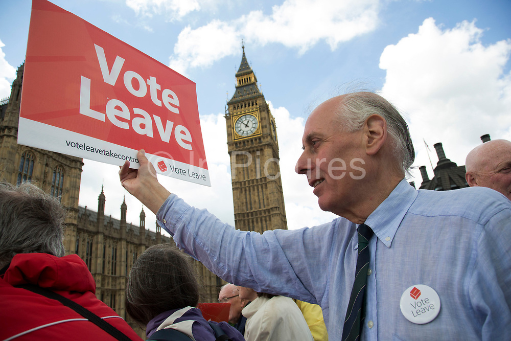 As a flotilla of fishing vessels on the River Thames arrive outside the Houses of Parliament, protesters gather to cheer them on as part of the Vote Leave Campaign, to make the case for Brexit in the EU Referendum on June 15th in London, United Kingdom. The flotilla was organised by Scottish skippers as part of the Fishing for Leave campaign which is against European regulation of the fishing industry, and the CFP (Common Fisheries Policy). Between 30 and 35 trawlers travelled up the Thames, through Tower Bridge and moored in the Pool of London. (photo by Mike Kemp/In Pictures via Getty Images)