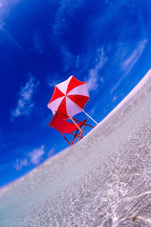 Beach chair & beach umbrella on an empty Australian beach