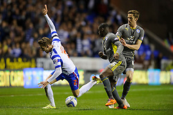 Chris Gunter (WAL) of Reading is challenged by Jeffrey Schlupp (GHA) of Leicester City - Photo mandatory by-line: Rogan Thomson/JMP - 07966 386802 - 14/04/2014 - SPORT - FOOTBALL - Madejski Stadium, Reading - Reading v Leicester City - Sky Bet Football League Championship.