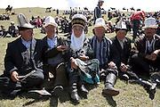 Spectators at a traditional Kyrgyz horse games festival. Bosogo jailoo, Naryn province, Kyrgyzstan.
