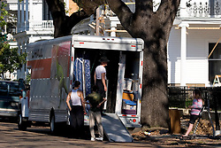 06 Oct, 2005. New Orleans, Louisiana. Hurricane Katrina aftermath.<br /> Moving out. Residents of St Charles Avenue in the Uptown neighbourhood bring in  U-Haul truck to take away their belongings as they prepare to start life anew away from New Orleans.<br /> Photo; ©Charlie Varley/varleypix.com
