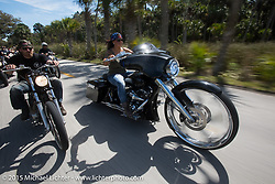"Crystal Oxendine (R) rides her 30"" front wheel custom Harley-Davidson Street Glide through Tamoka State Park during Daytona Beach Bike Week  2015. FL, USA. Friday, March 13, 2015.  Photography ©2015 Michael Lichter."