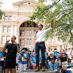 Former presidential candidate JULIAN CASSTRO rallies the crowd after a thousand Texas Democrats rally at the State Capitol supporting voting rights bills stalled in Congress and decrying Republican efforts to thwart voter registration and access to the polls.