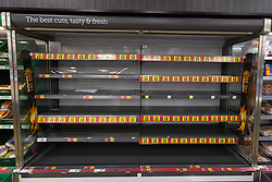 © Licensed to London News Pictures.  22/07/2021. London, UK. Empty shelves in Iceland, Hackney, east London. Supermarkets have warned they could start running out of food in 48 hours. Many stores had to close due to a lack of workers having to self-isolate.  Photo credit: Marcin Nowak/LNP