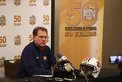 Auburn head coach Gus Malzahn speaks with the media at the Marriott Marquis hotel, Wednesday, December 27, 2017, in Atlanta. Auburn will face UCF in the Chick-fil-A Peach Bowl on January 1, 2018. (Jason Parkhurst via Abell Images for Chick-fil-A Peach Bowl)