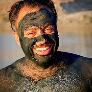 Mud-covered man at Dead Sea, Jordan (December 2007)