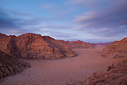 A high desert valley at dusk in Wadi Rum, Jordan.
