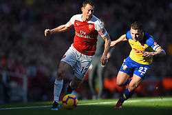 February 24, 2019 - London, England, United Kingdom - Arsenal defender Stephan Lichtsteiner is watched by Southampton midfielder Pierre-Emile Hojbjerg during the Premier League match between Arsenal and Southampton at the Emirates Stadium, London on Sunday 24th February 2019. (Credit Image: © Mi News/NurPhoto via ZUMA Press)