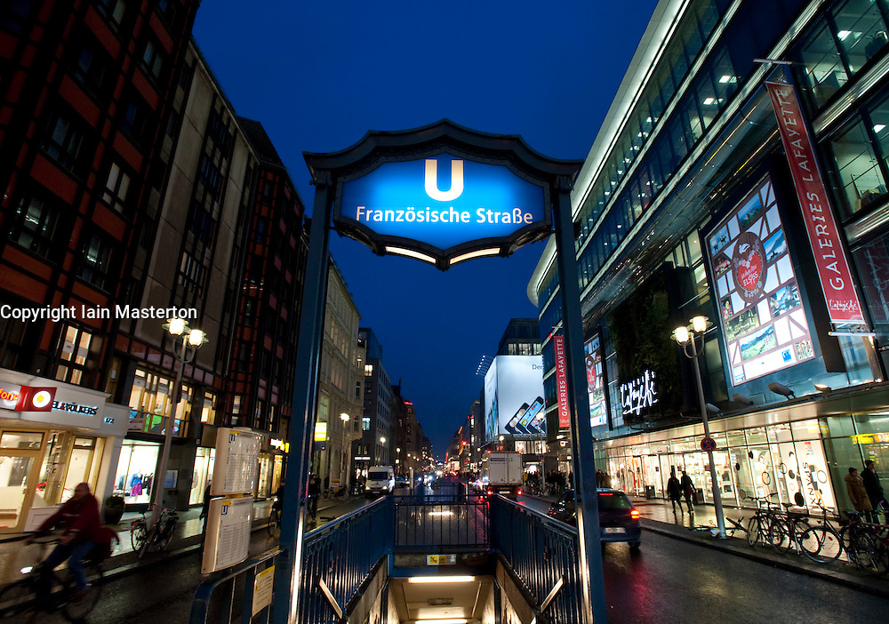 View of Friedrichstrasse at night at entrance to Franzosische Strasse subway ststion in Mitte Berlin Germany