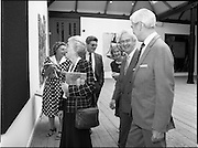10/09/1988<br /> 09/10/1988<br /> 10 September 1988<br /> ROSC 1988 Exhibition at the Guinness Hop Store. <br /> Sir Norman Mcfarlane visits ROSC '88. Mr Pat Murphy, (centre) Chairman of ROSC, shows the exhibition to Sir Norman Macfarlane, Chairman of Guinness plc and Lady Gretta Macfarlane during their visit to ROSC '88.