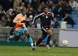 MARSEILLE, FRANCE - Tuesday, December 11, 2007: Liverpool's Ryan Babel beats Olympique de Marseille's Jacques Faty to score the fourth goal during the final UEFA Champions League Group A match at the Stade Velodrome. (Photo by David Rawcliffe/Propaganda)