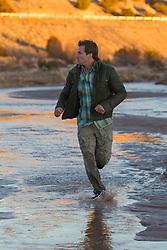 man running through a river
