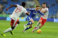 Cardiff City's Craig Noone (c) takes on Barnsley's Conor Hourihane (r). EFL Skybet championship match, Cardiff city v Barnsley at the Cardiff city stadium in Cardiff, South Wales on Saturday 17th December 2016.<br /> pic by Carl Robertson, Andrew Orchard sports photography.