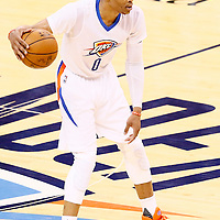 06 May 2016: Oklahoma City Thunder guard Russell Westbrook (0) brings the ball up court during the San Antonio Spurs 100-96 victory over the Oklahoma City Thunder, during Game Three of the Western Conference Semifinals of the NBA Playoffs at the Chesapeake Energy Arena, Oklahoma City, Oklahoma, USA.