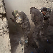 Canadian soldiers take cover from the dust and wind of a Canadian helicopter during an operation targeting insurgents in the village of Chalghowr in Panjwa'i (Panjwaii) District, Kandahar Province, Afghanistan. .(Credit Image: © Louie Palu/The Alexia Foundation/ZUMA Press).June 22, 2010...