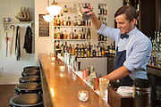Bartender and owner of the Wickman House, Mike Holmes, makes a Moscow Mule at the Ellison Bay, Wisconsin restaurant on Thursday July 14, 2016. Photos by Mike Roemer