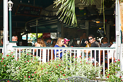 October 7, 2016 - West Palm Beach, Florida, U.S. - Things start to return to normal at E.R . Bradley's in downtown West Palm Beach on Friday, October 7, 2016, the day after Hurricane Matthew brushed the Palm Beach County coast line. (Credit Image: © Joe Forzano/The Palm Beach Post via ZUMA Wire)