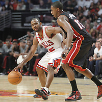 14 March 2012: Miami Heat point guard Mario Chalmers (15) defends on Chicago Bulls point guard John Lucas III (15) during the Chicago Bulls 106-102 victory over the Miami Heat at the United Center, Chicago, Illinois, USA.