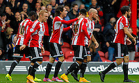 Brentford FC's Jota celebrates his second goal of the season during the Sky Bet Championship match between Brentford and Reading at Griffin Park, London<br /> Picture by Mark D Fuller