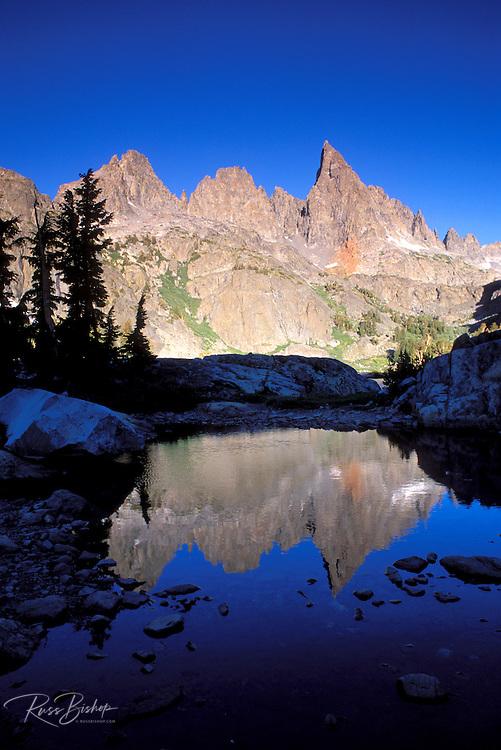 Morning light on the Minarets reflected in an alpine tarn, Ansel Adams Wilderness, Sierra Nevada Mountains, California