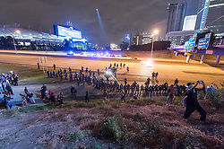 September 22, 2016 - Charlotte, North Carolina, United States of America - September 22, 2016 - Charlotte, NC, USA - Riot police clear the highway during a third day of protests in Charlotte, North Carolina on Thursday, Sept. 22, 2016. This is the third day of protests that erupted after a police officer's fatal shooting of an African-American man Tuesday afternoon and the first full day of a declared State of Emergency by the governor. (Credit Image: © Sean Meyers via ZUMA Wire)