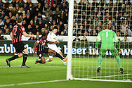 Ki Sung-Yueng of Swansea city © shoots and  scores his teams 1st goal. Barclays Premier league match, Swansea city v Queens Park Rangers at the Liberty stadium in Swansea, South Wales on Tuesday 2nd December 2014<br /> pic by Andrew Orchard, Andrew Orchard sports photography.