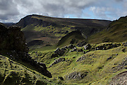 Hiking along the Quiraing, beautiful scenery along the Trotternish Peninsula, at the northern end of the Isle of Skye, Scotland