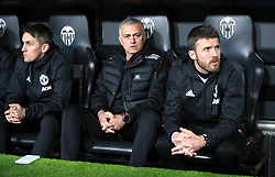 Manchester United manager Jose Mourinho (centre) and Coach Michael Carrick (right)
