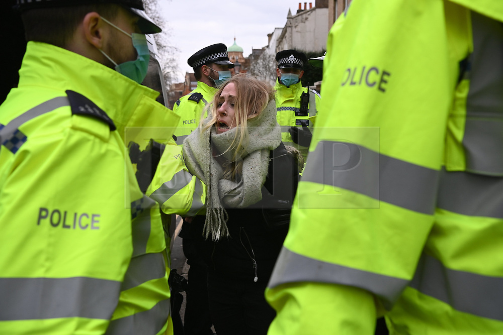 © Licensed to London News Pictures. 06/03/2021. London, UK. A anti-vaccination and anti-lockdown protester is arrested by police officers at a demonstration organised by Jam For Freedom in Richmond.  The group is using music to create positive effects and health against the current tier regulations and anti-vaccination for the Covid-19 disease.  Photo credit: Ray Tang/LNP