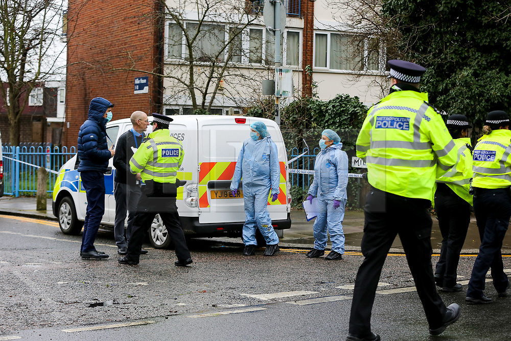 © Licensed to London News Pictures. 20/01/2021. London, UK. Police and forensic officers on West Green Road in Haringey, north London as police launch a murder investigation following the fatal stabbing of a teenage boy in Haringey. Police were called at 21:10hrs on Tuesday 19 January 2021 to the West Green Road junction with Willow Walk, following reports of a stabbing. Officers attended with the London Ambulance Service and found a male, aged 17, suffering from a stab injury. The victim was pronounced dead at 04:25hrs on Wednesday 20 January. . Photo credit: Dinendra Haria/LNP