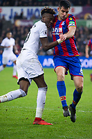 Football - 2017 / 2018 Premier League - Swansea City vs. Crystal Palace<br /> <br /> Tammy Abraham of Swansea City & Scott Dann of Crystal Palace collide , at the Liberty Stadium.<br /> <br /> COLORSPORT/WINSTON BYNORTH