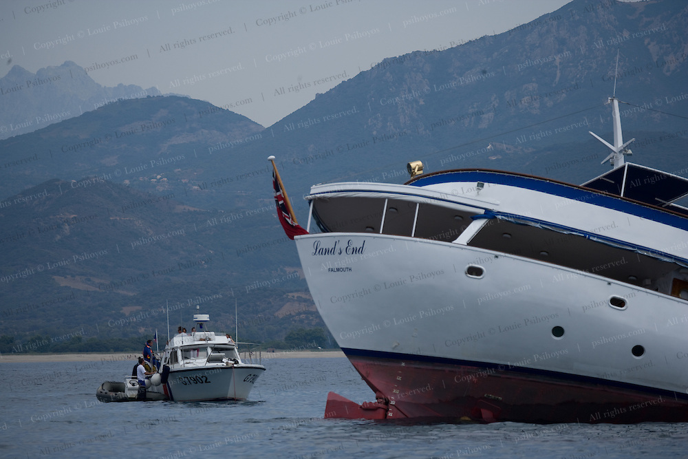 """The 48-meter luxury yacht Land's End suffered severe damage Tuesday August 9th, 2005 after running aground on the St. Joseph Rocks in the Bay of Sagone, Corsica. It was heading towards the beach at 10:30 a.m. under clear skies when it struck one of the many treacherous rocks dotting the popular west coast off the island.  None of the 25 passengers aboard were seriously injured yet there was concern about the 70,000 liters of diesel fuel leaking into the pristine waters.  Maritime authorities in Toulon issued a statement assuring pollution containment.  Caution is advised for boats of all sizes while traveling throughout the area.  According to Rod Heikell's Pilot, the respected nautical guide published by Imray, """"Care is needed in the approach because of the off lying reefs around the bay.  By day this is straight forward, but it should not be attempted a night.""""  The boat, which had been carrying 12 Portuguese charter guests was aground on rocks of depths from 2 to 5 meters.  Fortunately waters remained calm until Wednesday but a mistral is heading for the area on Friday."""