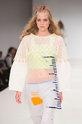 © Licensed to London News Pictures. 01/06/2015. London, UK. Collection by Yeni Park. Fashion show of Nottingham Trent University at Graduate Fashion Week 2015. Graduate Fashion Week takes place from 30 May to 2 June 2015 at the Old Truman Brewery, Brick Lane. Photo credit : Bettina Strenske/LNP